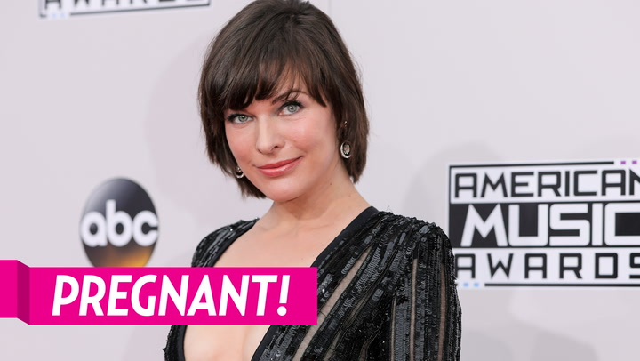 Pregnant Milla Jovovich Cradles Growing Baby Bump in Sweet Family Pic For 10th Wedding Anniversary