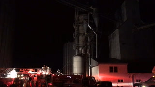 Firefighters from Brandon and Alexandria work at the scene of a grain elevator fire in downtown Brandon Friday night. (Celeste Edenloff | Echo Press)