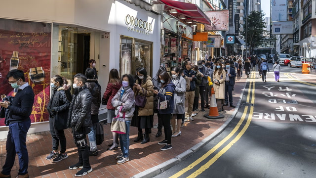 Long lines form as people clamor for masks in Wuhan and Hong Kong