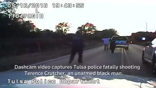 A still image captured from a video from Tulsa Police Department shows Terence Crutcher seen with his hands in the air during a police shooting incident in Tulsa, Oklahoma, on September 16, 2016. Courtesy Tulsa Police Department/Handout via REUTERS