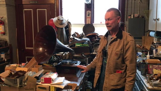 Collector John Vraa of Climax, Minn., cues up a vintage Bessie Smith record from the early 20th century at his shop in Climax. Vraa always uses a brand-new needle when he plays the vintage records. Vraa collects and restores old phonographs and has more than 50. Eric Hylden / Forum News Service