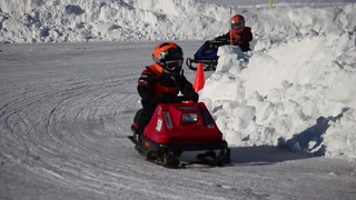 Kids brave cold temps for snowmobile races on Pike Lake