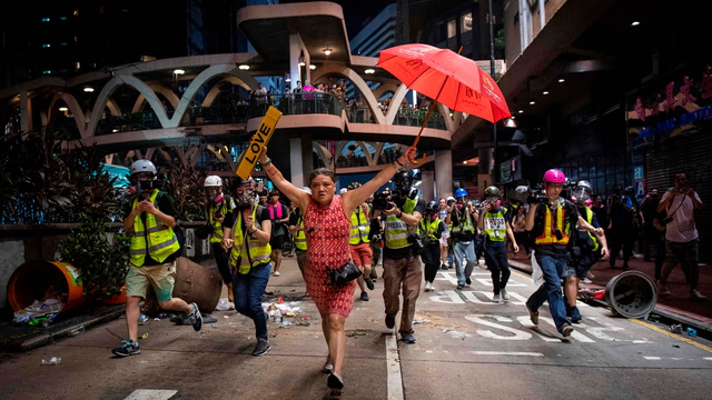 Hong Kong democracy protesters show resolve as China celebrates Communist rule