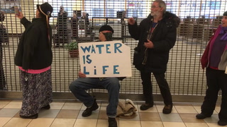 Enbridge Line 3 protesters block entrance to Wells Fargo in downtown Duluth