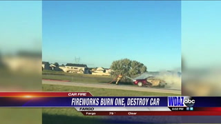 Fireworks accident destroys car and burns one passenger