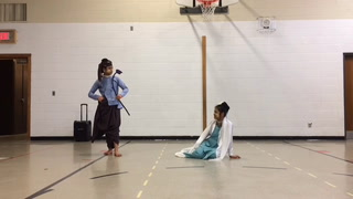 Two Burmese ALC students perform a traditional dance from their home country Friday morning during Culture Day. (Martina Baca / Daily Globe)