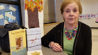 Marion Blumenthal Lazan, a child Holocaust survivor,  shows an actual yellow Star of David that she was forced to wear identifying her as a Jew in Nazi Germany. She and her family were imprisoned in the notorious Bergen-Belsen concentration camp before the camp was liberated in April of 1945. Lazan spoke to students at Fisher High School Monday and will speak tonight at Senior High in East Grand Forks. (Photo by Eric Hylden/Grand Forks Herald)