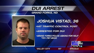 Man arrested for DUI after hitting traffic control signal post