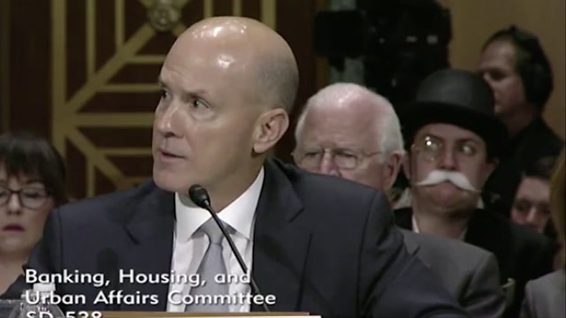 Former Equifax CEO trolled during hearing by Monopoly character