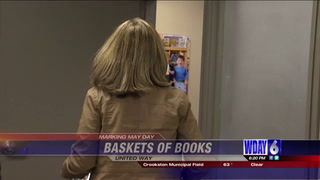 United Way celebrating May Day with books to children